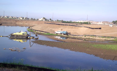 United Storm Water field crew and equipment performing permitted excavation services on lake bed