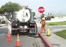 United Storm Water field crew and pumping equipment on-site to clean storm drain