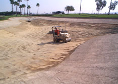 United Storm Water equipment excavating a lake bed to prepare for lake liner installation